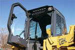 Дверь кабины со стеклоочистителем и обогревателем или комбинированным кондиционером /обогревателем повышает комфортность работы для оператора.